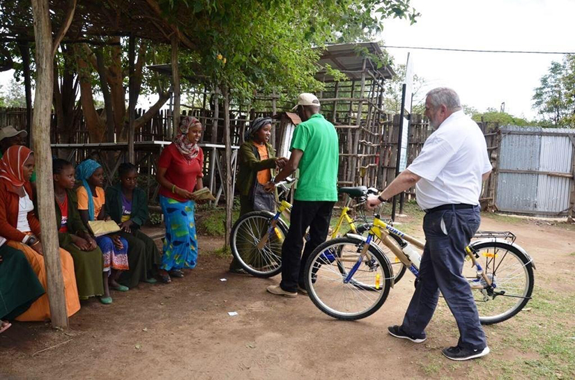ChildFund Ethiopia Country Director Chege Ngugi and ChildFund Ireland CEO Michael Kiely presenting Dream Bikes