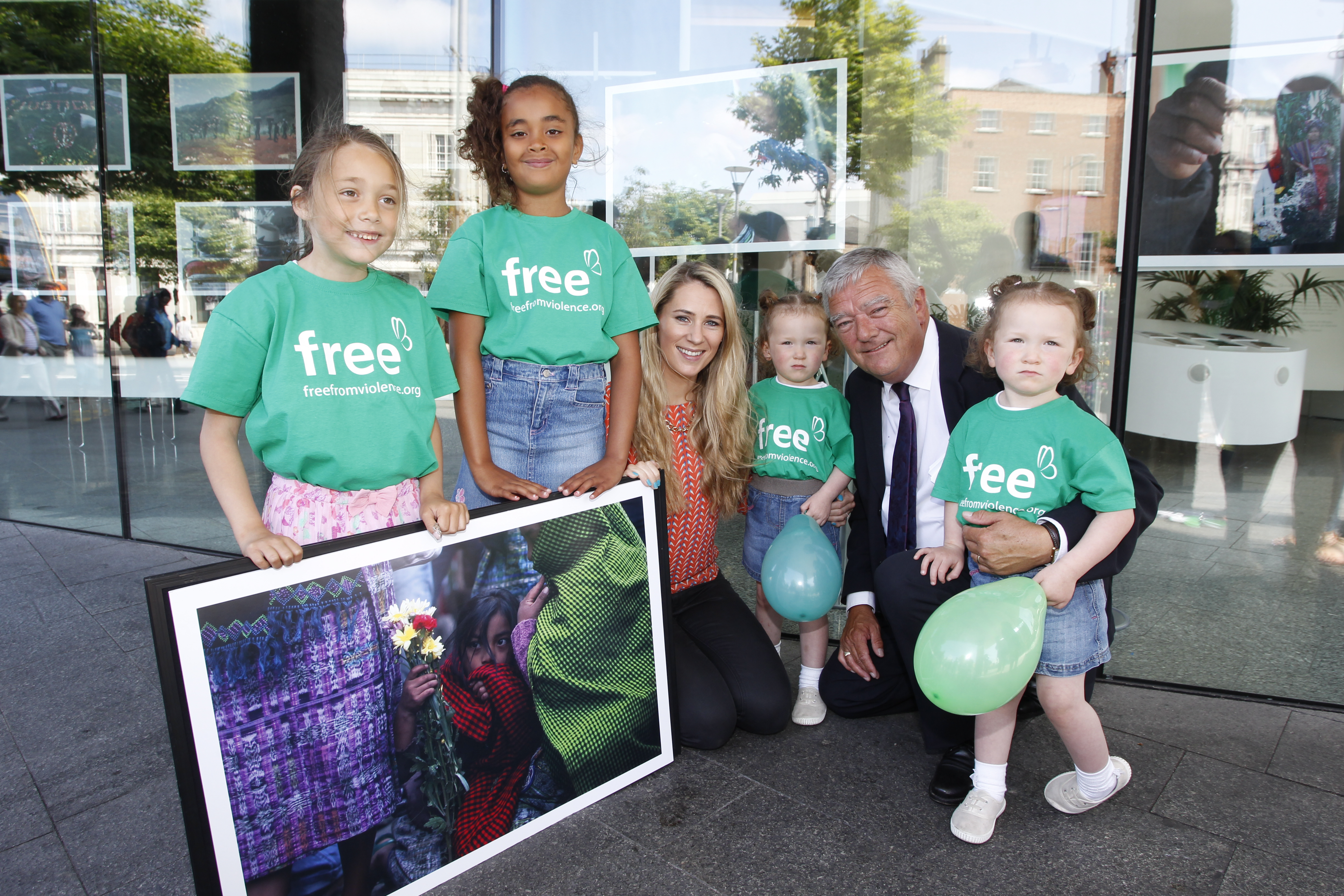Mick Kiely, CEO of Childfund Ireland, with his twin granddaughers (about 4 years old) and a couple of older girls.