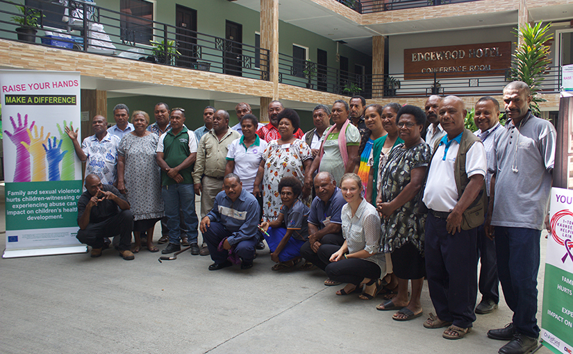 A group of 25 men and women in Papua New Guinea standing together after completing their human rights training.
